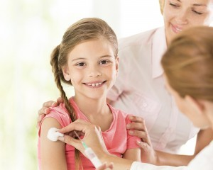 Young Girl getting an injection by a doctor